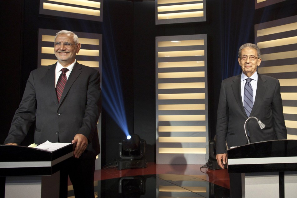 Egyptian presidential hopefuls Amr Moussa and Abdel Moneim Abol Fotouh take part in a televised debate in Cairo