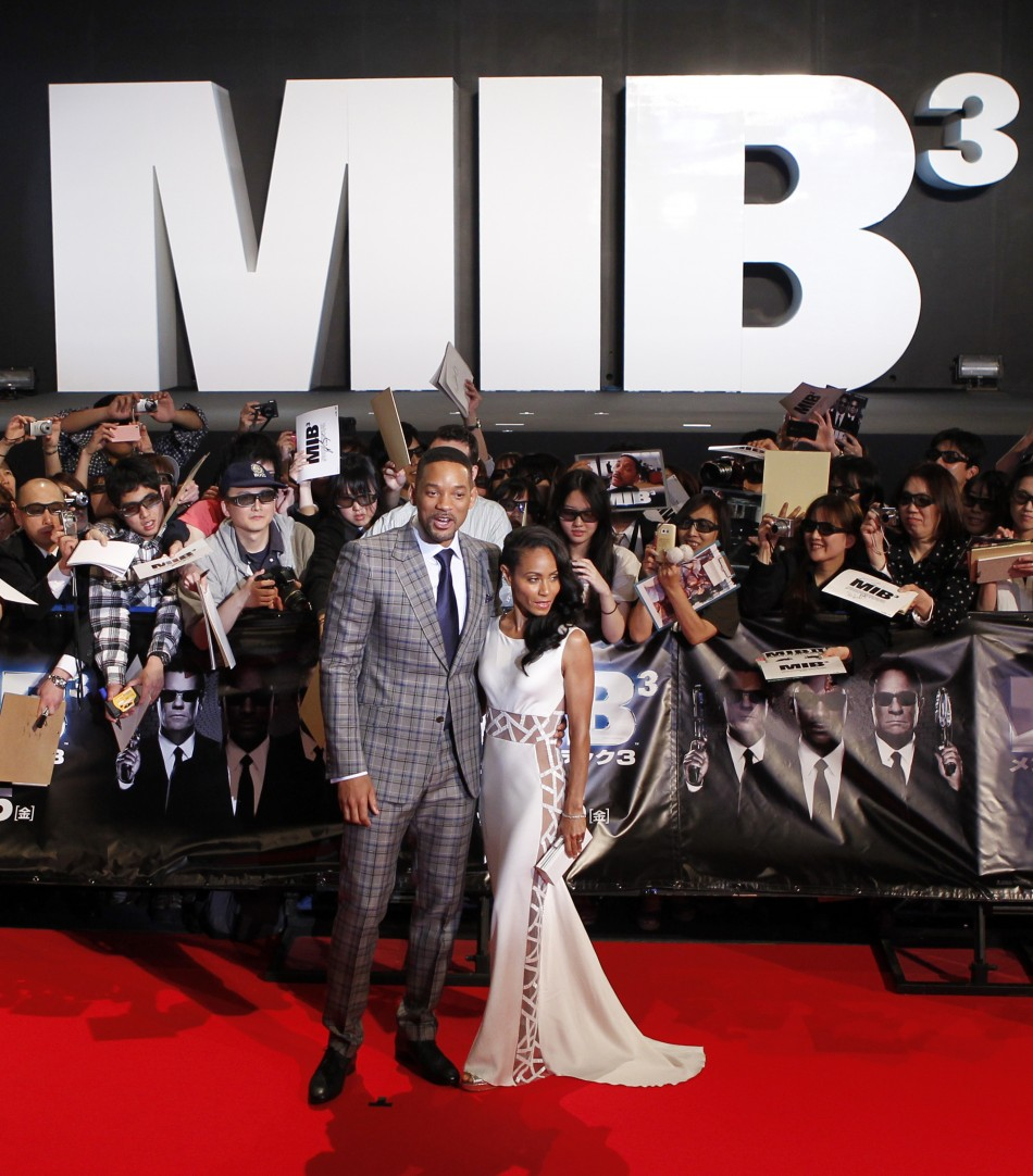 "Cast member Will Smith and his wife Jada Pinkett Smith pose during a red carpet event to promote the film ""Men in Black III"" in Japan"