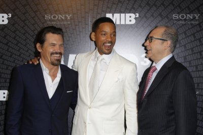 Cast members Smith and Brolin pose with director Sonnenfeld during a photocall to promote their film quotMen in Black IIIquot in Paris