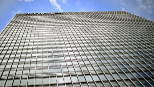Sun reflects off the JPMorgan headquarters at Canary Wharf in London May 11, 2012.