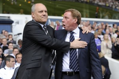 Fulham manager Martin Jol greets Tottenham Hotspur manager Harry Redknapp before their English Premier League match at White Hart Lane