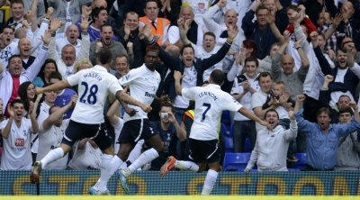 Tottenham Hotspur players celebrate Emmanuel Adebayor039s goal against Fulham during their English Premier League match at White Hart Lane