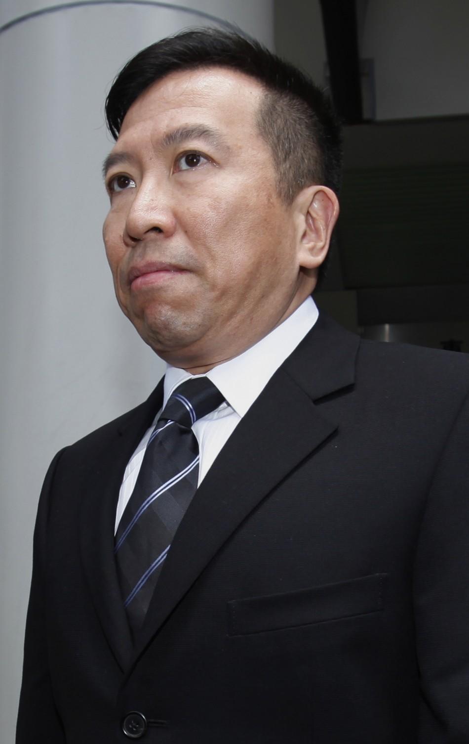 Feng shui master Tony Chan leaves court in Hong Kong