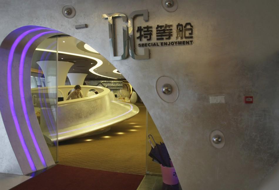 A waitress is seen through the entrance of an A380 theme restaurant in Chongqing municipality