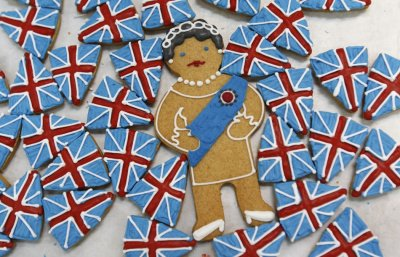 Biscuits depicting Britains Queen Elizabeth and the Union flag sit on trays at Biscuiteers in London