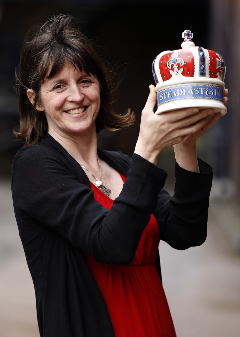 Emma Bridgewater poses with a crown shaped pot, part of her Diamond Jubilee Collection, at the Emma Bridgewater pottery factory in Stoke-On-Trent