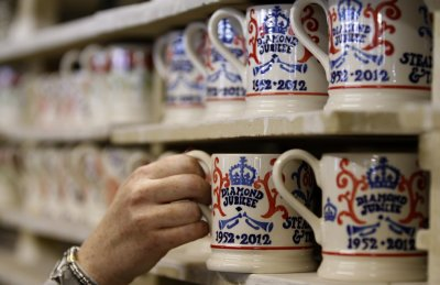 A worker examines a mug as part of the Diamond Jubilee Collection at the Emma Bridgewater pottery factory in Stoke-On-Trent