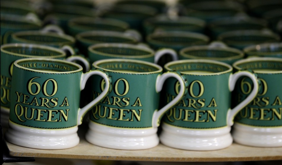 Mugs from the Diamond Jubilee Collection stand on a shelf at the Emma Bridgewater pottery factory in Stoke-On-Trent