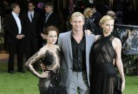 "Actors Stewart, Hemsworth and Theron pose for photographers as they arrive for the world premiere of ""Snow White and the Huntsman"" at Leicester Square in London"