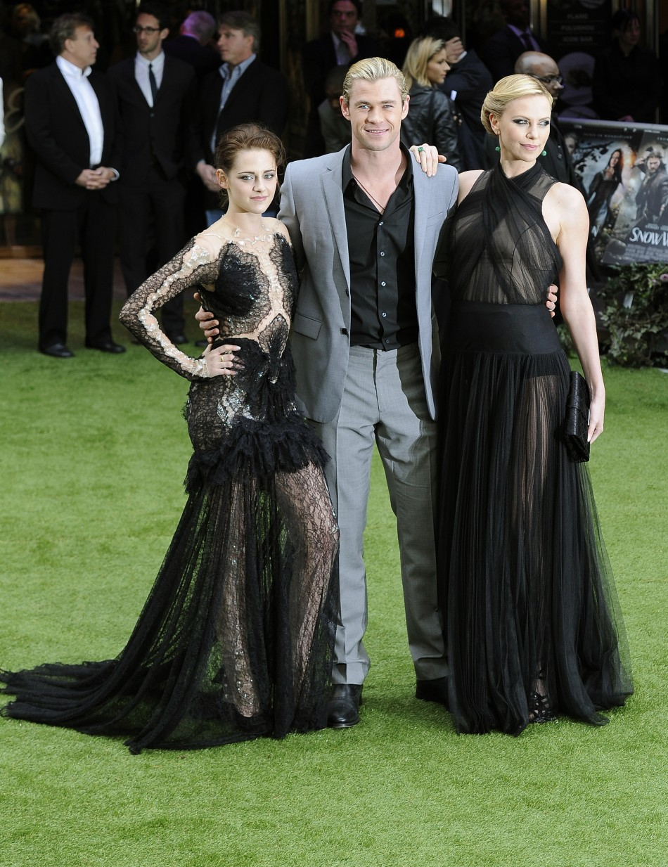 Actors Stewart, Hemsworth and Theron pose for photographers as they arrive for the world premiere of quotSnow White and the Huntsmanquot at Leicester Square in London