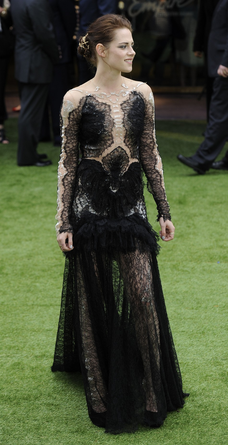 """Actress Kristen Stewart poses for photographers as she arrives for the world premiere of """"Snow White and the Huntsman"""" at Leicester Square in London"""