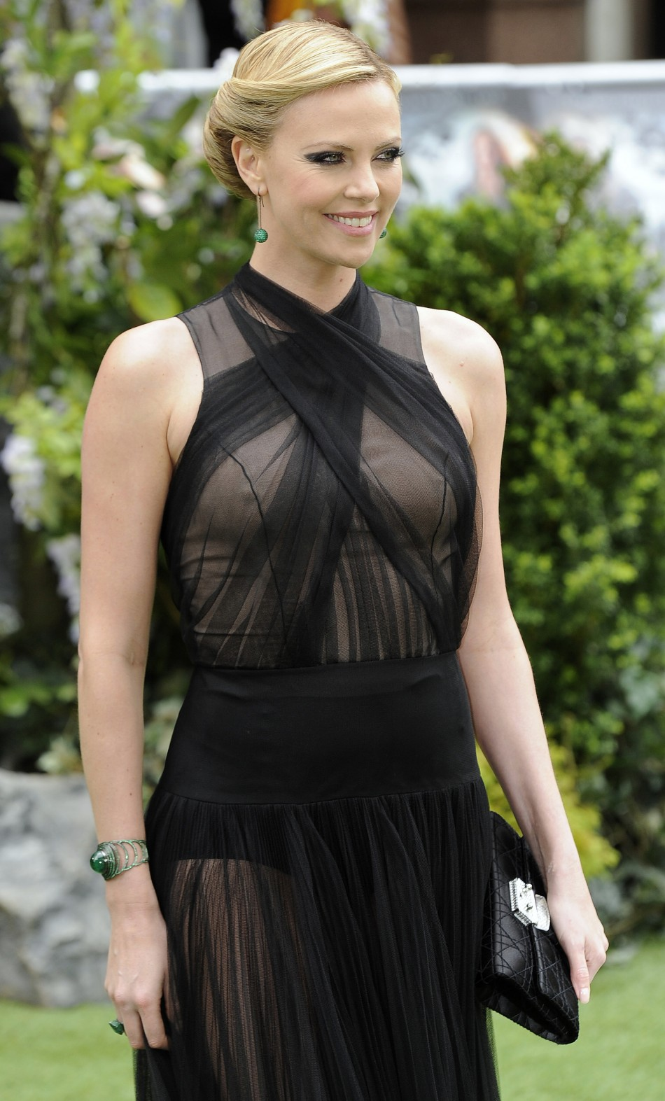 """Actress Charlize Theron poses for photographers as she arrives for the world premiere of """"Snow White and the Huntsman"""" at Leicester Square in London"""