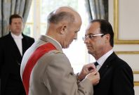 """France's newly-elected President Francois Hollande is awarded """"Grand Maitre"""" in the Order of the Legion of Honour"""