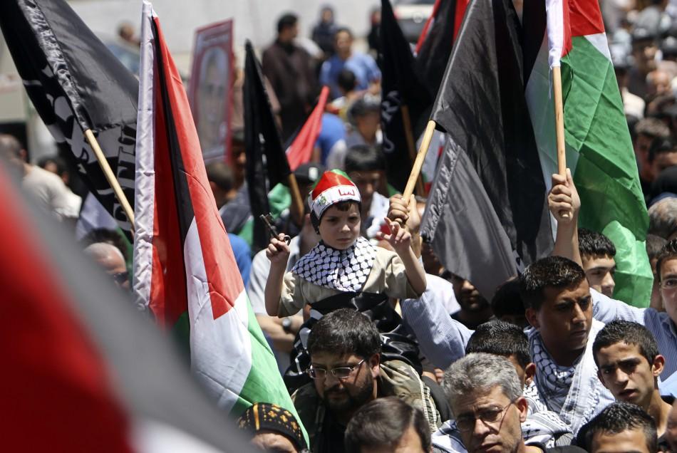 Palestinians take part in a rally marking Nakba in Ramallah