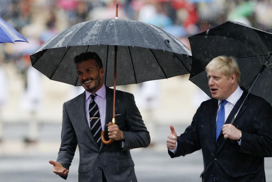 David Beckham and London039s Mayor Boris Johnson enter the Panathenaic stadium before an Olympic Flame handover ceremony in Athens