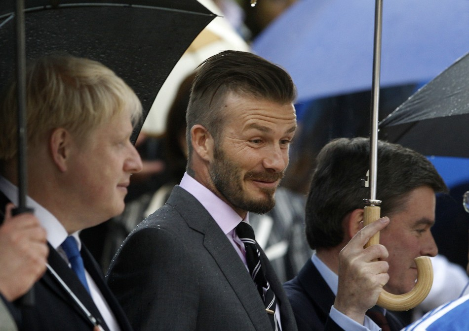 British soccer player David Beckham enters the all-marble Panathenaic stadium before an Olympic Flame handover ceremony in Athens