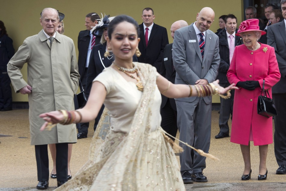 Britain039s Queen Elizabeth and Prince Philip watch a dancer during a visit to the Chester Zoo in northern England
