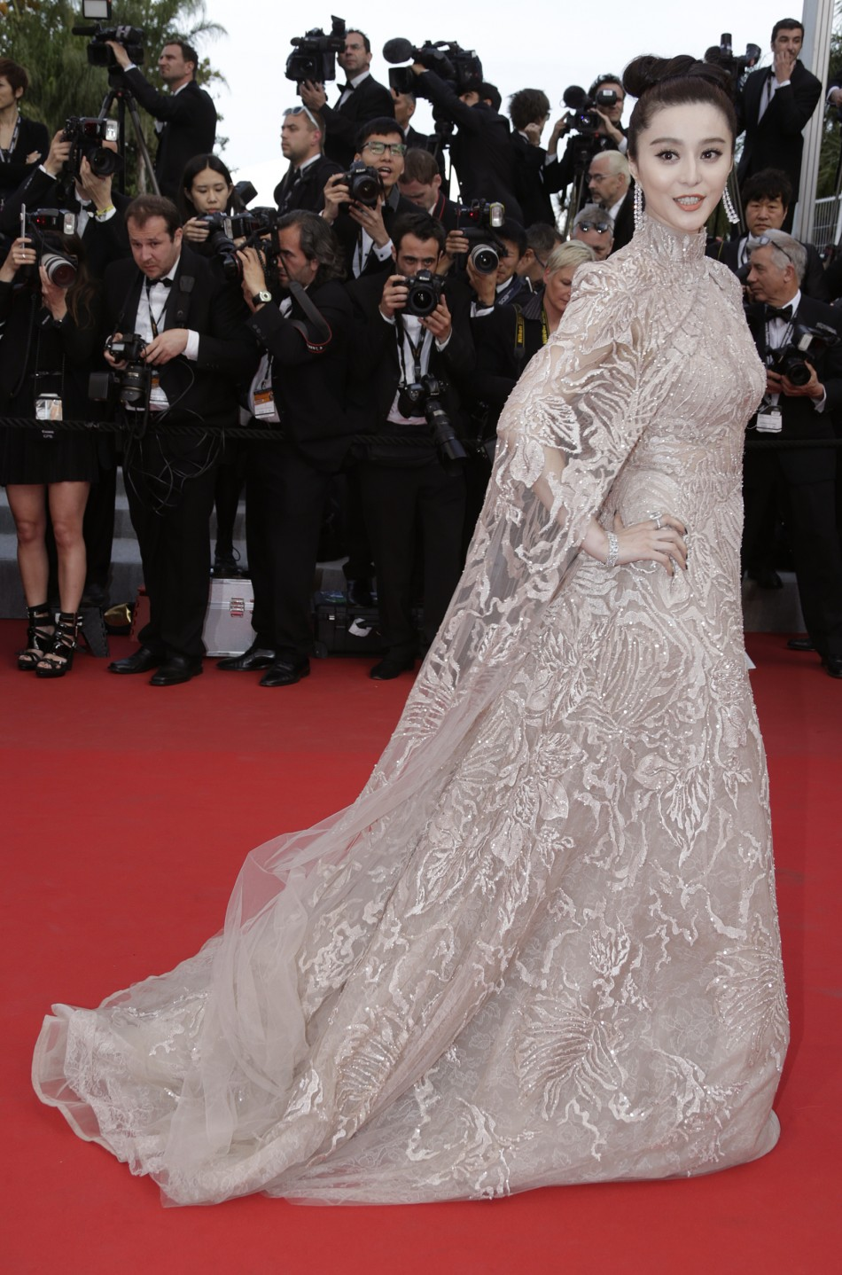 Actress Fan Bing Bing arrives on the red carpet for the screeing of the film De rouille et d'os at the 65th Cannes Film Festival