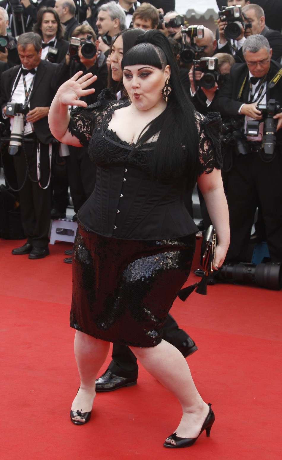 Singer Ditto arrives on the red carpet for the screening of the film De rouille et dos at the 65th Cannes Film Festival