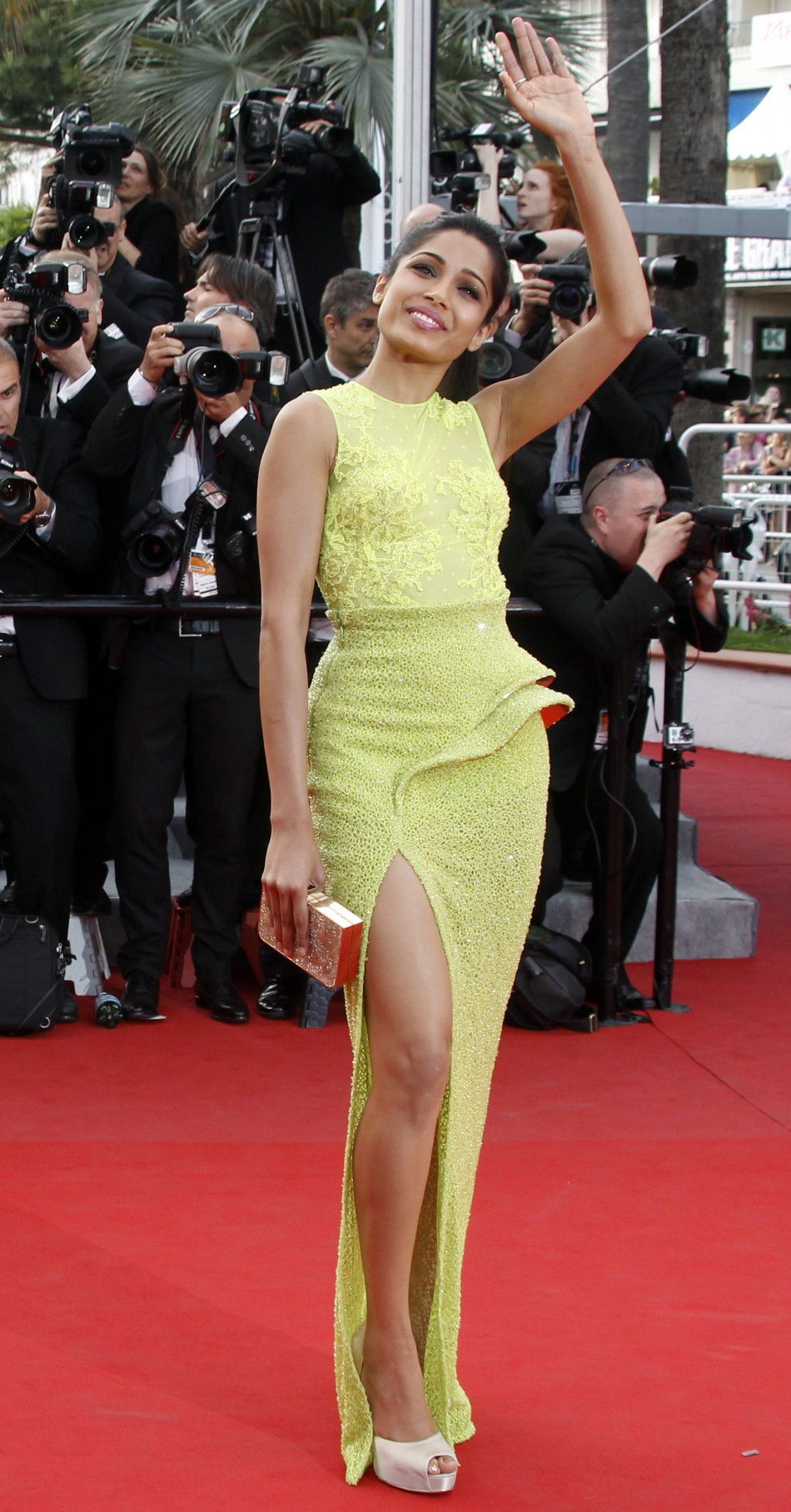 Actress Pinto arrives on the red carpet for the screeing of the film De rouille et d'os at the 65th Cannes Film Festival