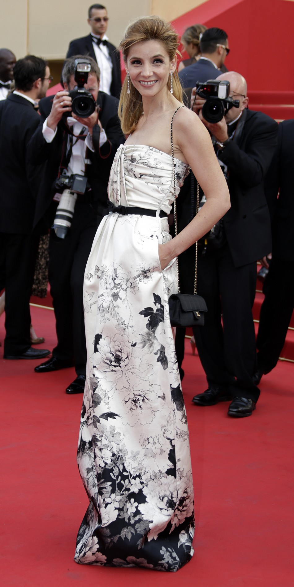 Actress Coureau arrives on the red carpet for the screeing of the film De rouille et d'os at the 65th Cannes Film Festival