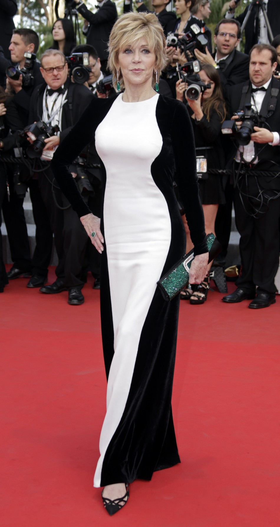 Actress Fonda arrives on the red carpet for the screeing of the film De rouille et dos at the 65th Cannes Film Festival