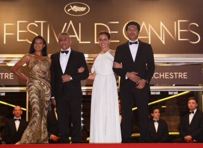 Director Nasrallah and cast members El Sebai Shalaby and Samra arrive on the red carpet for the screeing of the film Baad El Mawkeaa at the 65th Cannes Film Festival
