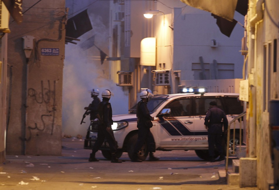 Riot police is seen patrolling the streets during clashes in the village of Bilad al-Qadeem, west of Manama