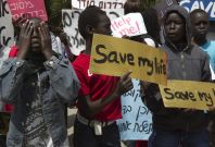 South Sudanese boys take part in a protest against their deportation outside the residence of Israeli Prime Minister Benjamin Netanyahu in Jerusalem April 1, 2012