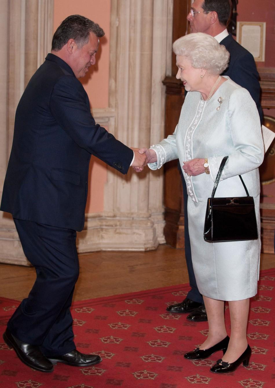 King Abdullah of Jordan is greeted by Britains Queen Elizabeth