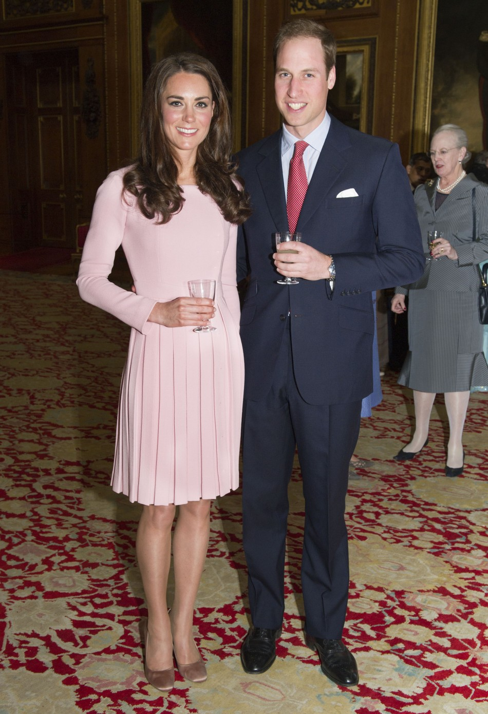 Britain's Prince William and Catherine, Duchess of Cambridge pose during a reception before Queen Elizabeth's Diamond Jubilee lunch at Windsor Castle in London