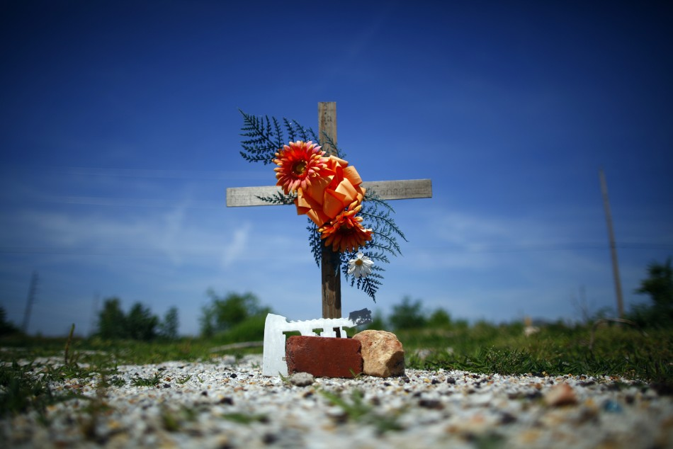 A memorial is seen where a house once stood in Joplin