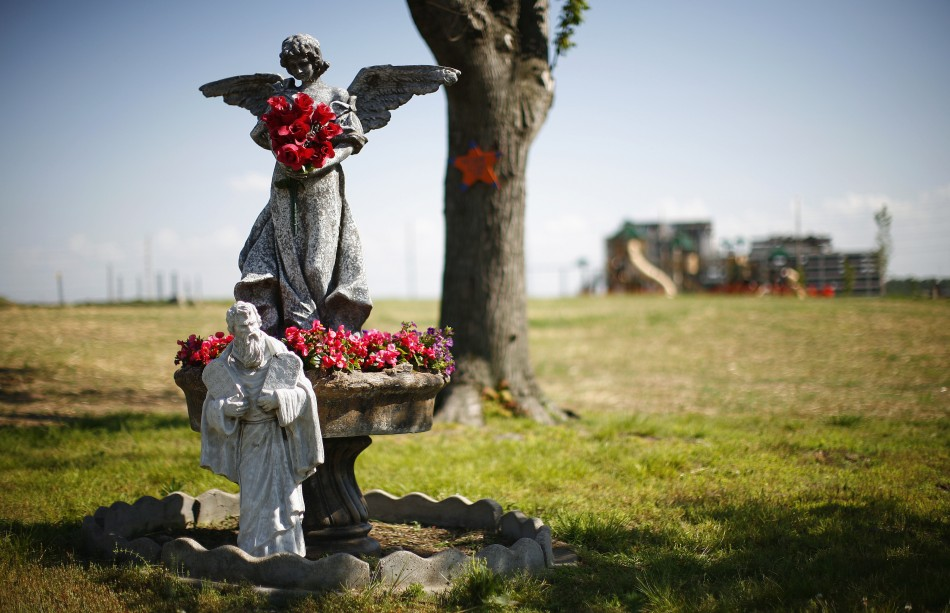 Statues are seen with flowers in Joplin