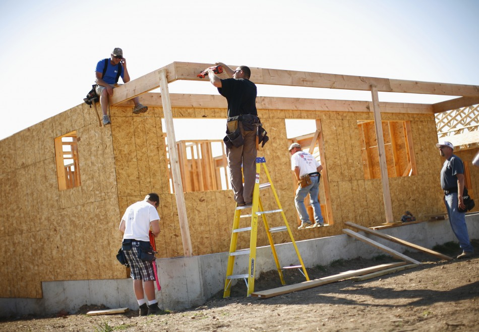 Workers construct a home in Joplin