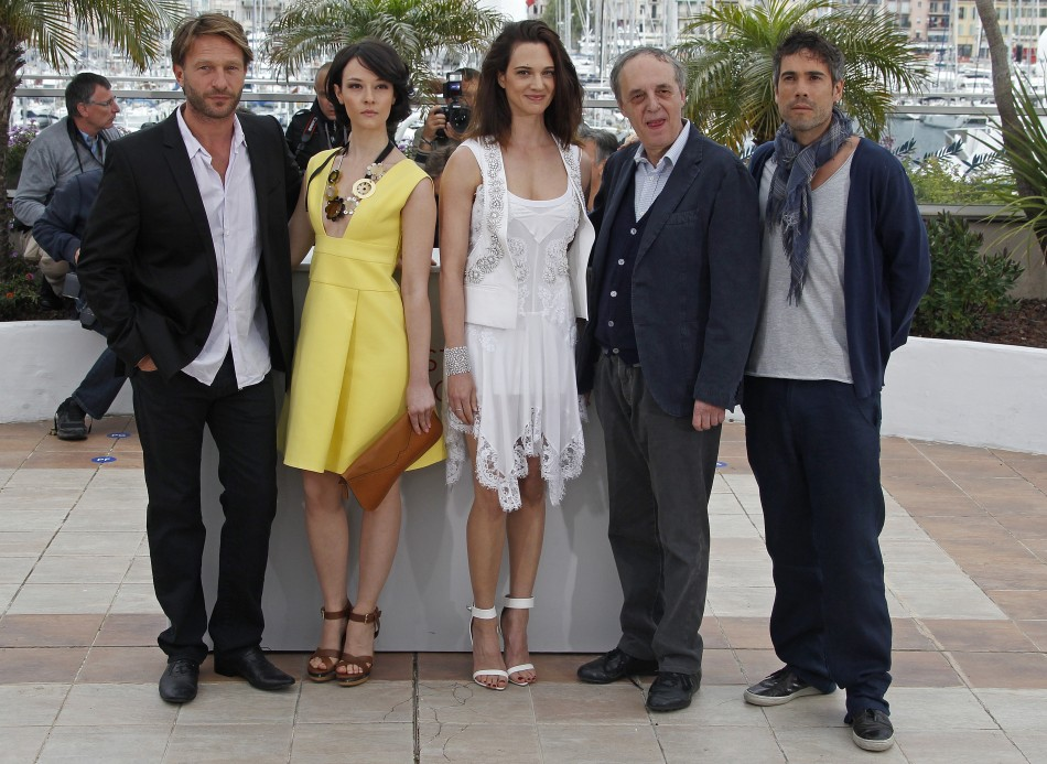 Director Argento poses with cast members during a photocall at the 65th Cannes Film Festival