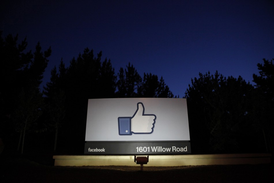 The sun rises behind the entrance sign to Facebook headquarters in Menlo Park before the company's IPO launch, May 18, 2012.