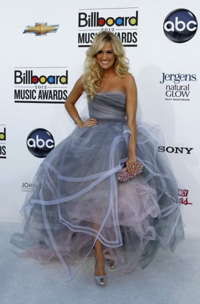Recording artist Carrie Underwood poses on the red carpet as she arrives at the 2012 Billboard Music Awards in Las Vegas