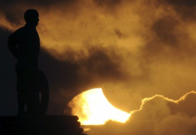 A partial eclipse is pictured behind a statue in Taiwan039s notherneast coast in New Taipei city