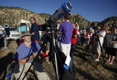Craig Halbasch watches a rare annular eclipse dims the sky, as the sun and moon align for quotring of firequot spectacle over the southwestern town of Kanarraville, Utah