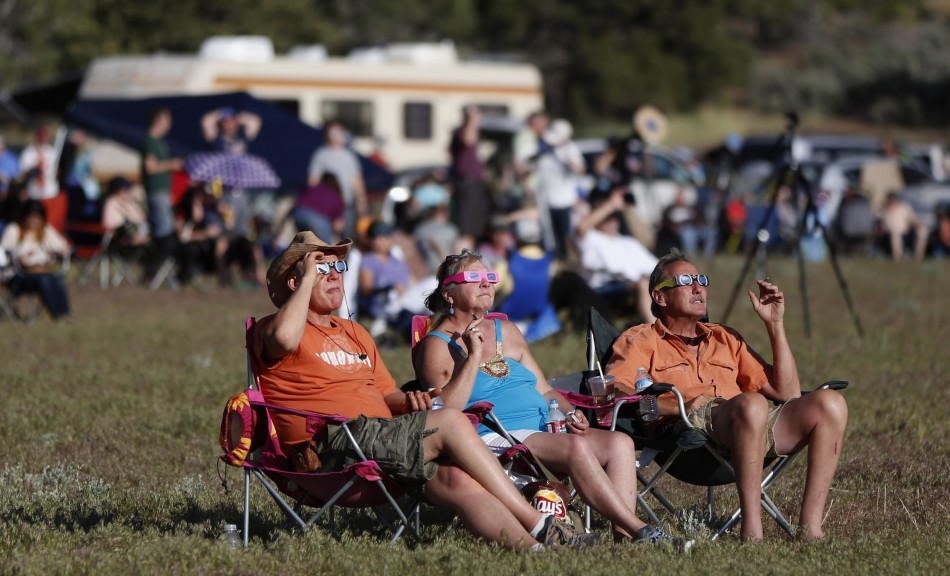 People watch a rare annular eclipse dims the sky, as the sun and moon align for quotring of firequot spectacle over the southwestern town of Kanarraville, Utah