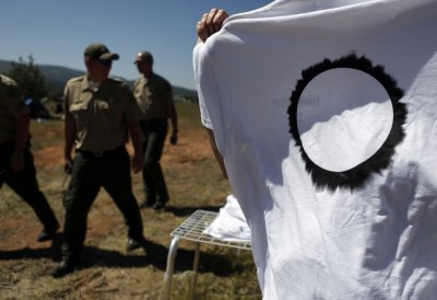 Shirts depicting an eclipse are sold by vendors before a rare annular eclipse dims the sky, in Kanarraville, Utah