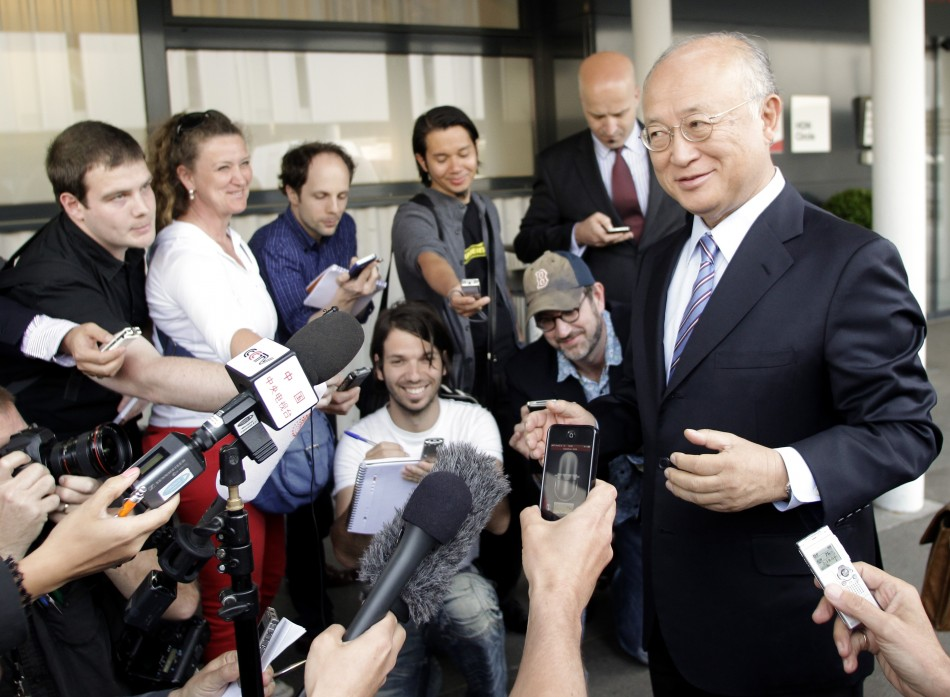 International Atomic Energy Agency (IAEA) Director General Yukiya Amano briefs the media after his trip to Tehran at the international airport in Vienna