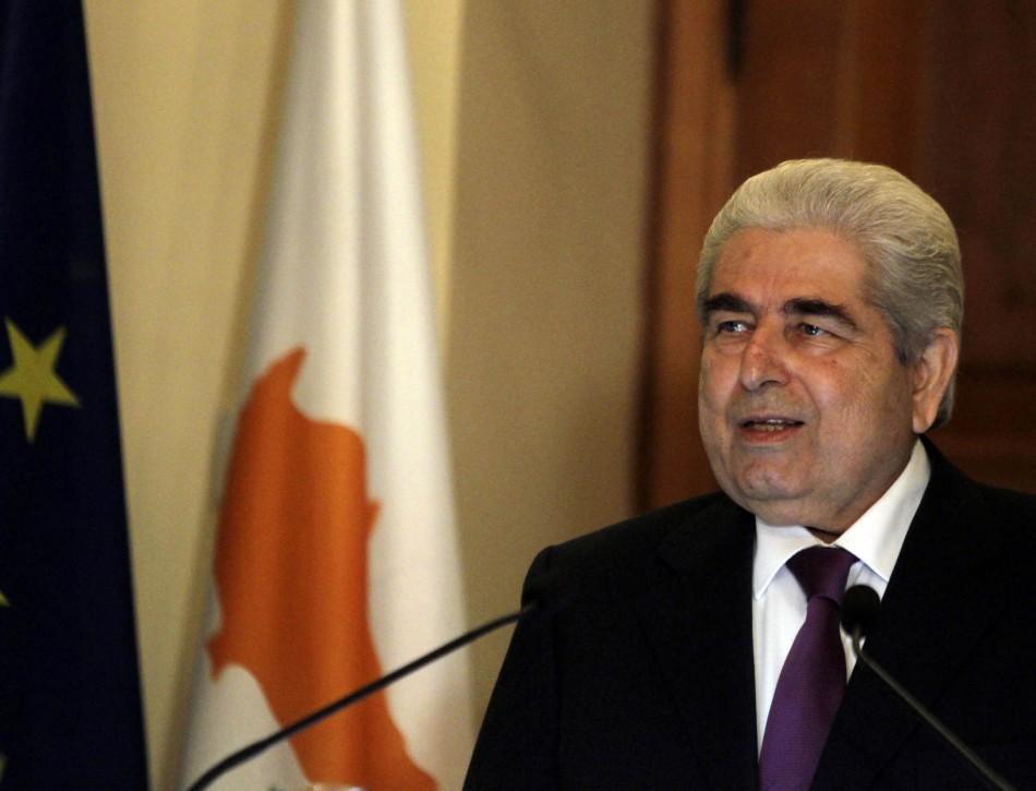 Cypriot President Demetris Christofias addresses the media in Cyprus