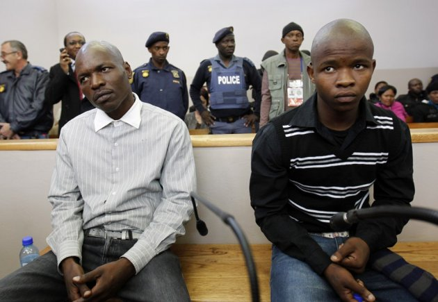 Mahlangu and Ndlovu look on during verdict hearing in Ventersdorp (Reuters)