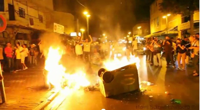 Violence surged in the streets of Tel Aviv as a 1000-strong protest against African immigrants seeking asylum in Israel turned violent.