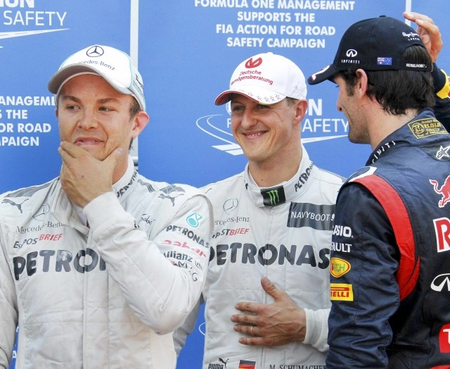 Michael Schumacher (M), Nico Rosberg (L) and Mark Webber