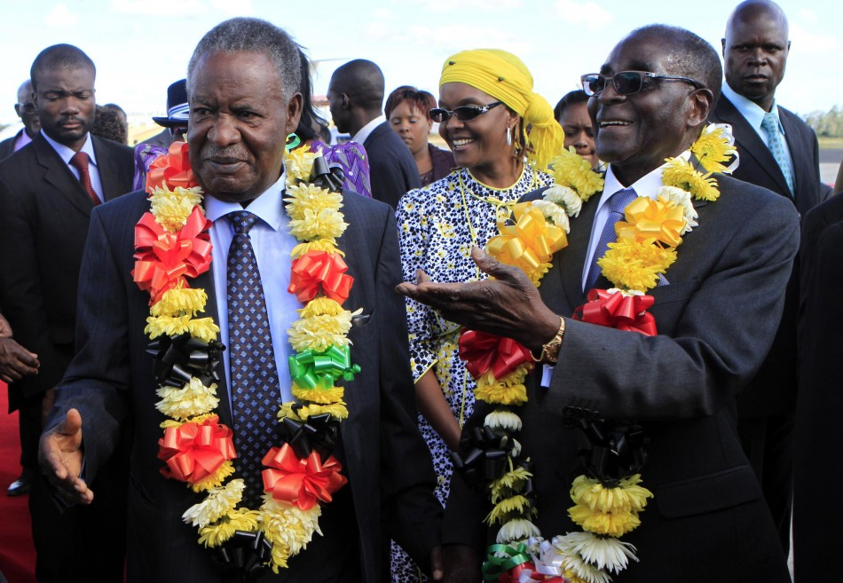 Zimbabwean President Robert Mugabe and his Zambian counterpart Michel Sata