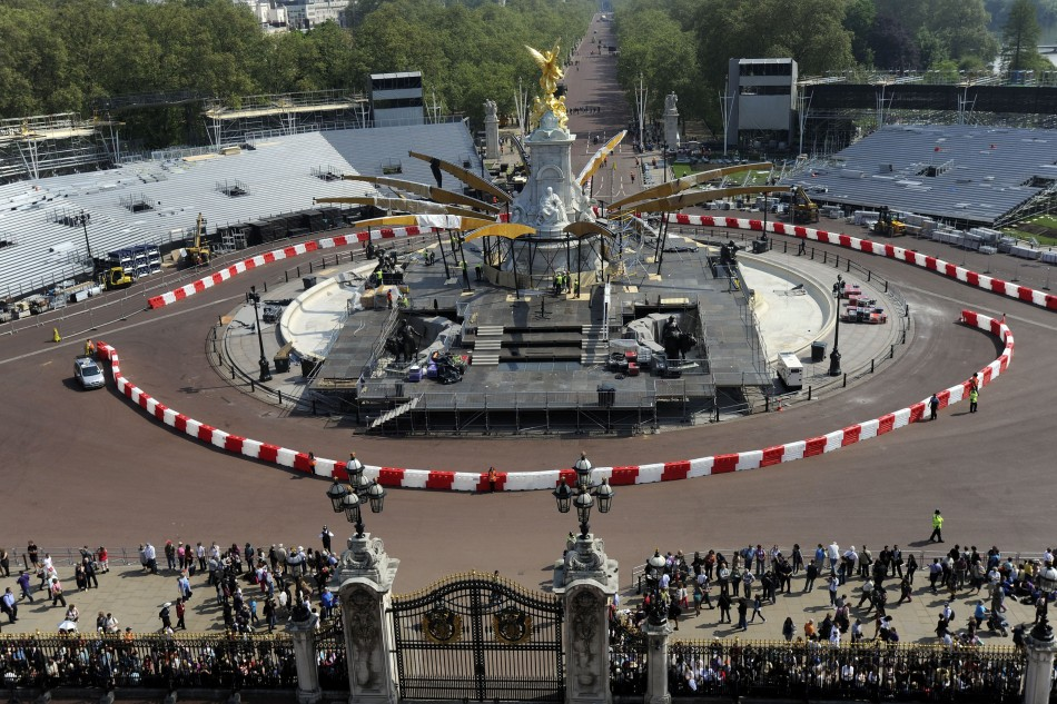 The Queen Victoria Memorial is prepared for Queen Elizabeth's Diamond Jubilee concert as seen from the roof of Buckingham Palace in London (Reuters)