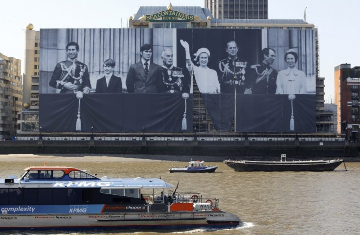 A giant canvas along the River Thames shows a photograph showing the Royal Family during the 1977 Silver Jubilee (Reuters)