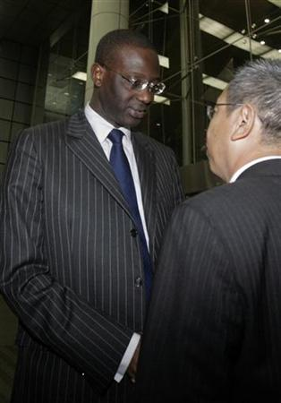 Prudential's CEO Tidjane Thiam shakes hands with local Prudential staff member after meeting with Prudential employees at a convention centre in Singapore